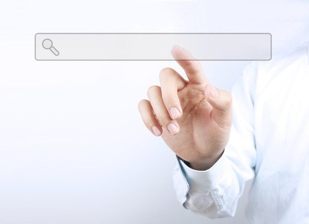 Businessman is touching a search bar on a virtual screen with his finger.