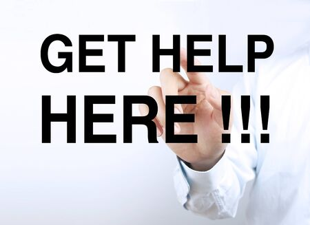 get help: Businessman hand is pressing the concept text of Get help here.