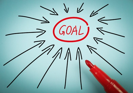 marketing goals: Set goal concept is on blue paper with a red marker aside. Stock Photo
