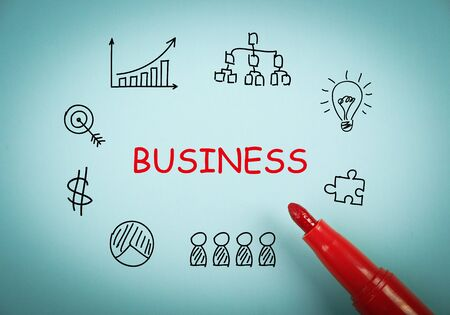 aside: Business graph is on blue paper with a red marker aside. Stock Photo