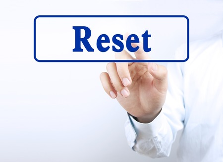 redesign: Businessman is pressing the reset button on the transparent screen.