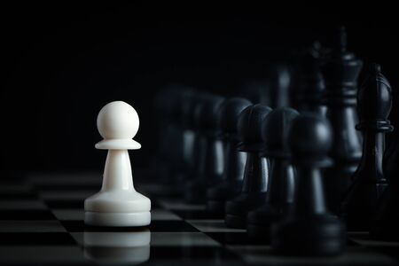 staying: One chess is staying against full army of chess pieces. Stock Photo