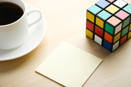 enigma: Note is on the table with Rubiks Cube and coffee aside. Editorial