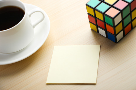 unsolved: Note is on the table with Rubiks Cube and coffee aside. Editorial