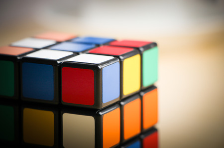 Rubik's Cube is on the table background. 에디토리얼