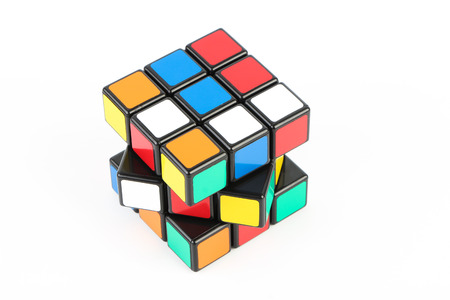 unsolved: Rubiks Cube is isolated on white background.