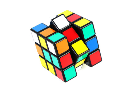 Rubiks Cube is isolated on white background.