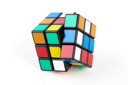 Rubik's Cube is isolated on white background. Editoriali