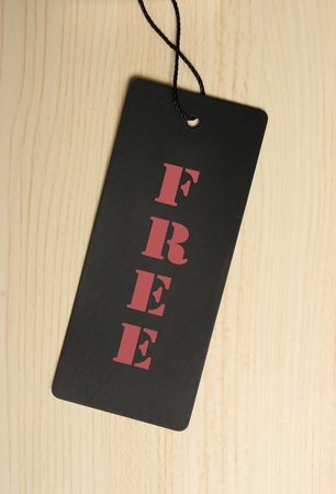 pricetag: Free label is on the wooden textured background.