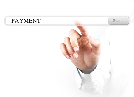 Businessman is touching the payment search bar with his hand isolated on white background. photo