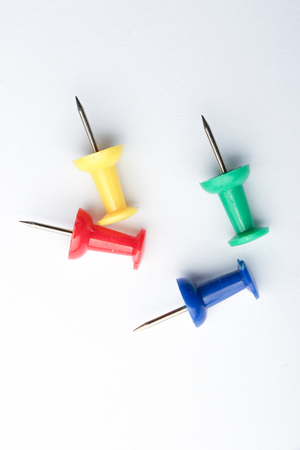 push in pins: Set of push pins in different colors on white background.