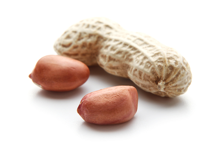 earthnut: Close up peanuts is isolated on white background.