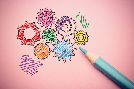 aside: Business concept of gears drawing on the paper with pencil aside. Stock Photo