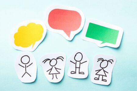 orange sign: Paper people with colorful blank dialog speech bubbles. Stock Photo