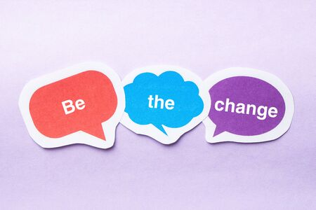 be the change: Be the change concept paper bubbles against purple background. Stock Photo