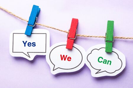 Yes we can paper bubbles with clip hanging on the line against purple background. Stok Fotoğraf