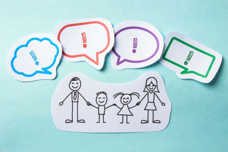 Happy paper family with speech bubbles of Success concept on the blue background.