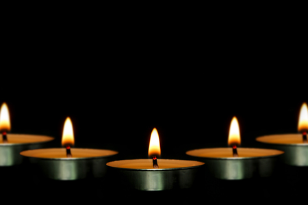 christian candle: Some candles are against the dark black background. Stock Photo