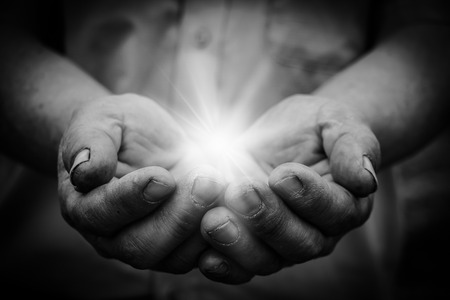 worship and praise: Light is in the holding hands with dark corners.