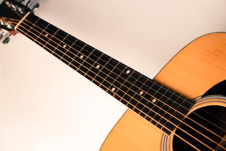frets: Closeup shot photo of the acoustic guitar.