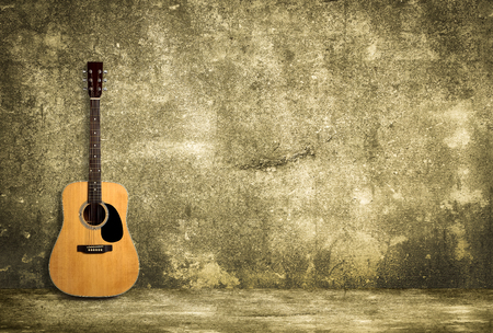 bluegrass: Acoustic guitar against old style wall
