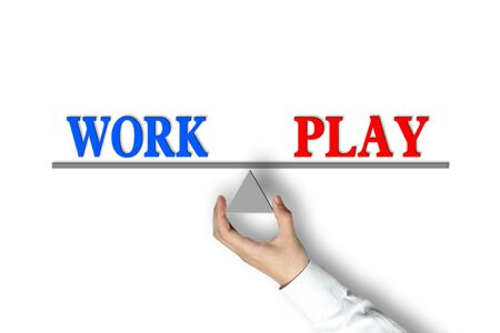 joyous: Work Play Balance concept with scale holden by businessman hand isolated on white background. Stock Photo