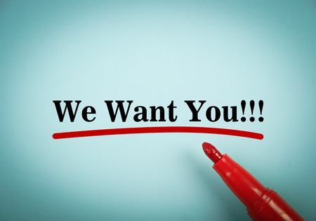 Text We want you with red underline and red marker aside on the blue background. Stock Photo