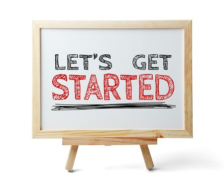 initiate: Whiteboard with text Let us get started isolated on white background.
