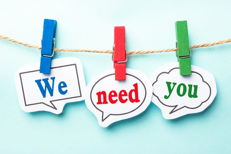 We need you concept paper speech bubbles with line on the light blue background.