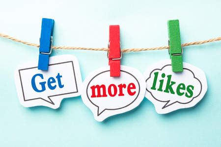 likes: Get more likes concept paper speech bubbles with line on the light blue background.