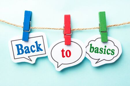 of back: Back to basics concept paper speech bubbles with line on the light blue background.