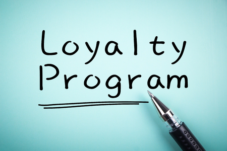 Text Loyalty Program with underline and a ball pen aside.
