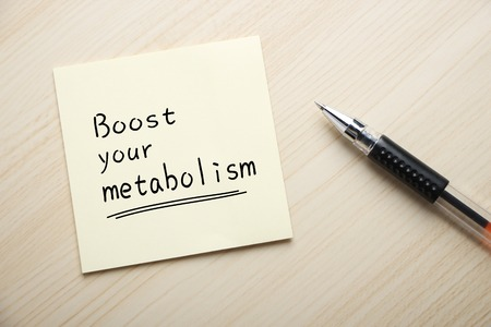 metabolism: Text Boost Your Metabolism written on the sticky note with pen aside. Stock Photo
