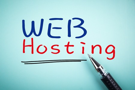 Text Web hosting with underline and a ball pen aside.