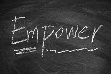 empower: Empower written on the blackboard with chalk