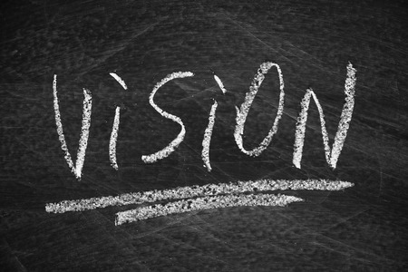 Vision written on the blackboard with chalk 스톡 콘텐츠