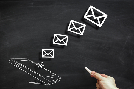sending: Sending message concept drawn on the black chalkboard. Stock Photo