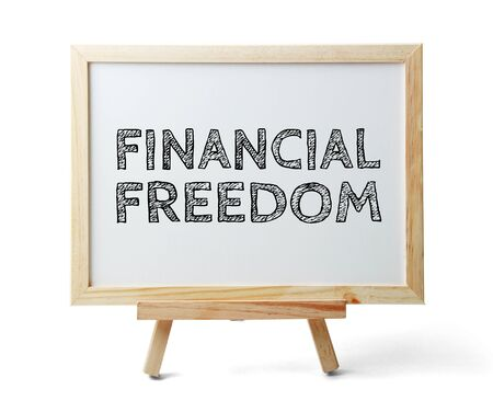 frugal: Whiteboard with text Financial Freedom is isolated on the white background.