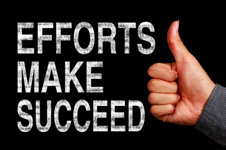 efforts: Text Efforts Make Succeed is written on the blackboard with thumb up hand aside.