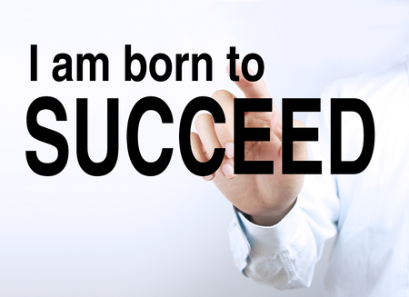 succeed: Businessman is pointing the text I am born to succeed on the virtual transparent screen. Stock Photo