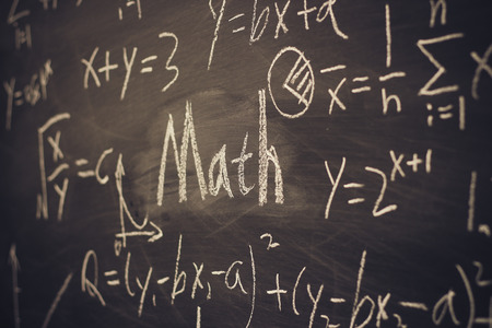 mathematics symbols: Math text with some maths formulas on chalkboard background.