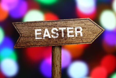 short phrase: Easter Ahead road sign with bokeh background. Stock Photo