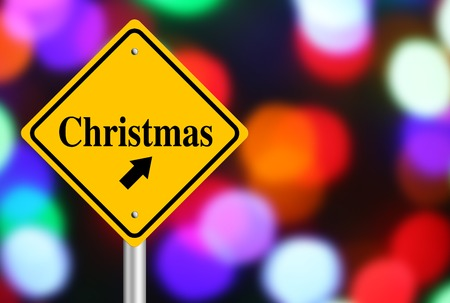 coincidence: Christmas ahead road sign with beautiful bokeh background.