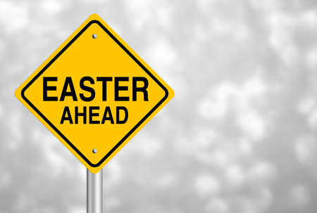 short phrase: Easter Ahead road sign with beautiful bokeh background.