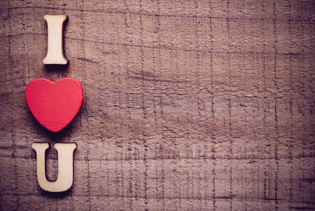 sentimental: I love you text on the rustic wooden background. Stock Photo