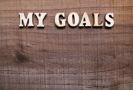 cooperating: My Goals text with rustic wooden background.