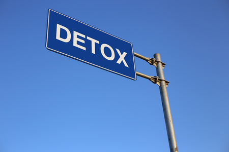 detoxing: Detox Road Sign with clear blue sky background.