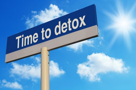 detoxing: Time To Detox road sign with blue sunny sky background.