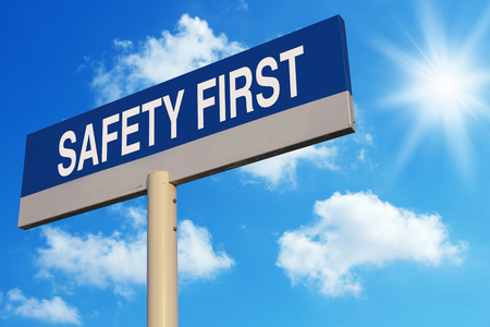 fairplay: Safety First road sign with blue sunny sky background.