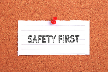 fairplay: Safety First note paper pinned on the cork background. Stock Photo